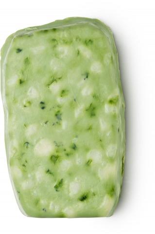 Grünes Seifenstück mit Kräutern